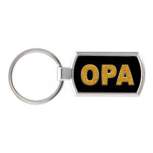 Foto van een sleutelhanger met het woord Opa erop